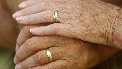 old hands with wedding rings