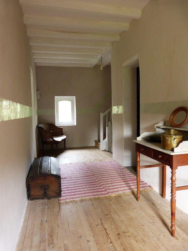 Couloir - Badigeon , enduit taloché, cimaise en stuc