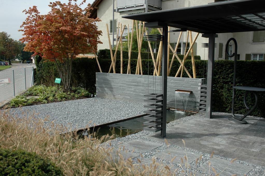 Eberhard_Gartenbau_Kloten, Wasserbecken, Pergola, Schichtenmauerwerk, Granitmauer