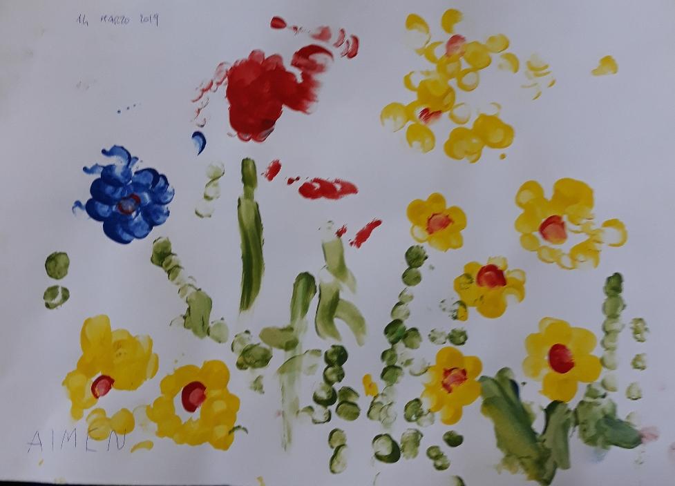 Gocce di colore impresse con le dita su cartoncino da disegno