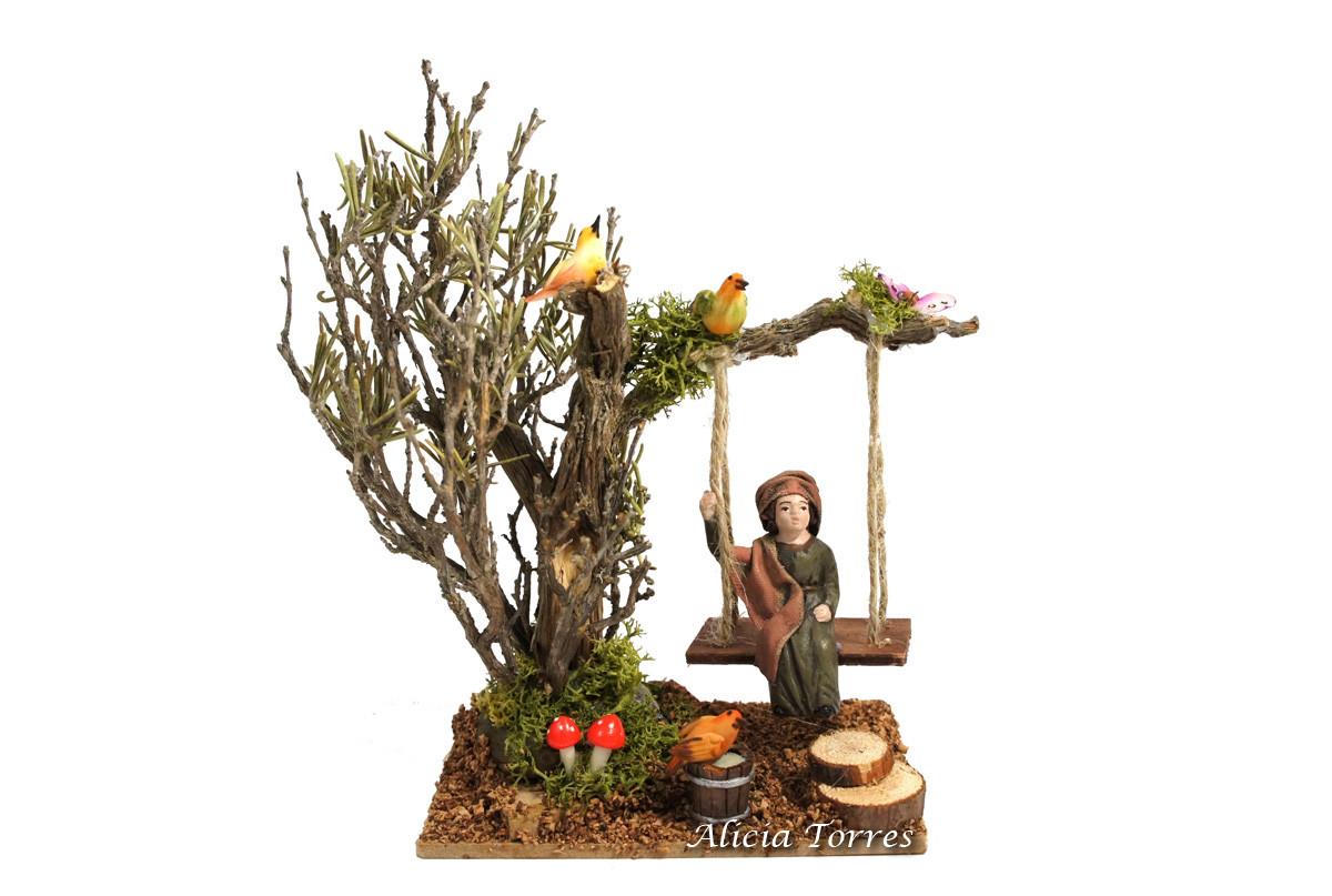 Árbol con columpio y niño de barro ref 2801 alicia torres