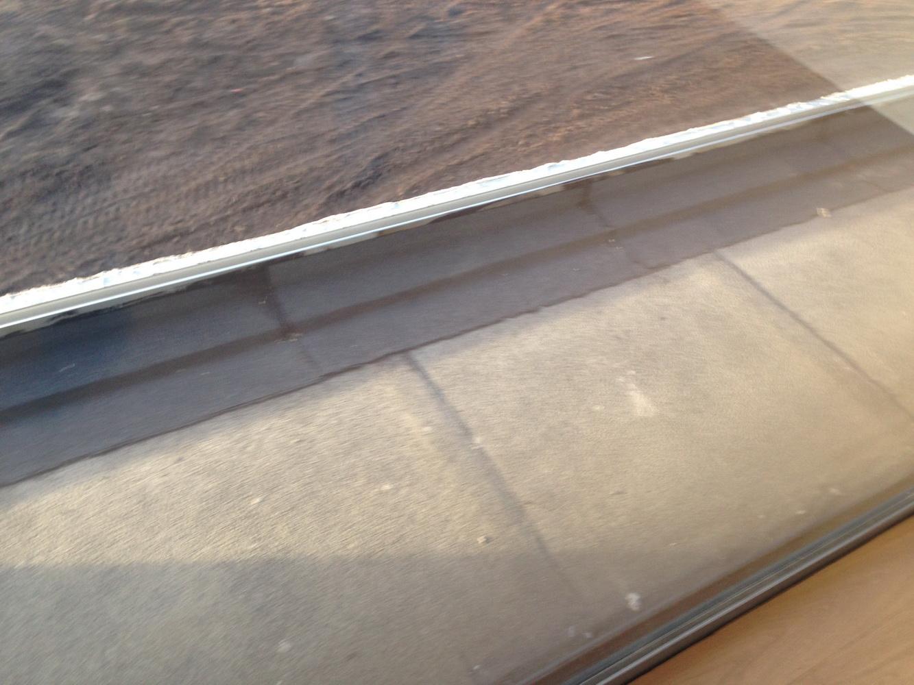 Une 2° couche de roofing recouvre la cornière.