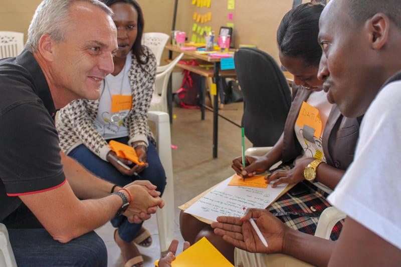 Joern with attendees at an Impact Week workshop in Rwanda