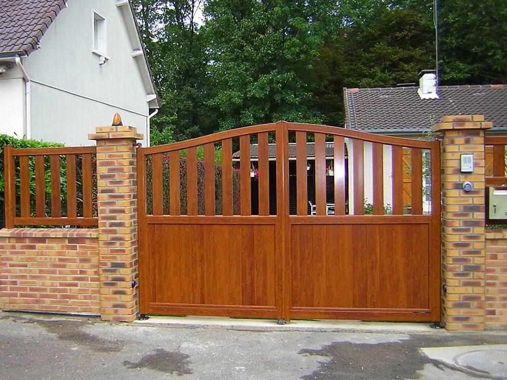 Puertas de jard n seccionales aluminios no in gar s for Puertas de jardin de madera