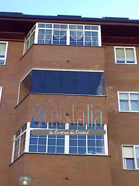 Cerramiento de terraza con cortina de vidrio