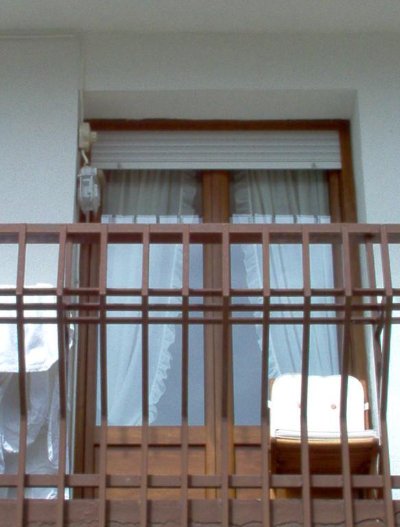 Puerta balconera en PVC de Kommerling en color embero