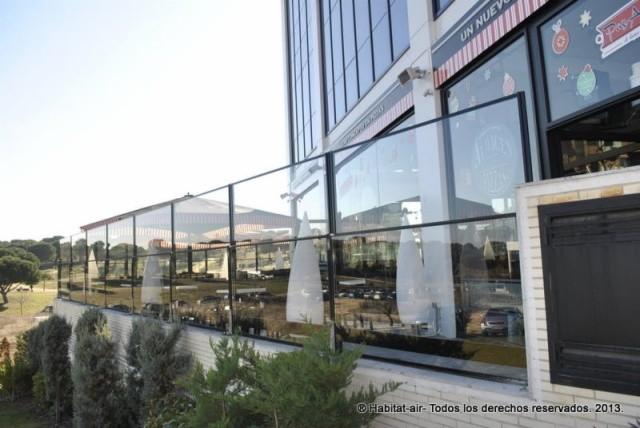 Cortavientos regulables de vidrio