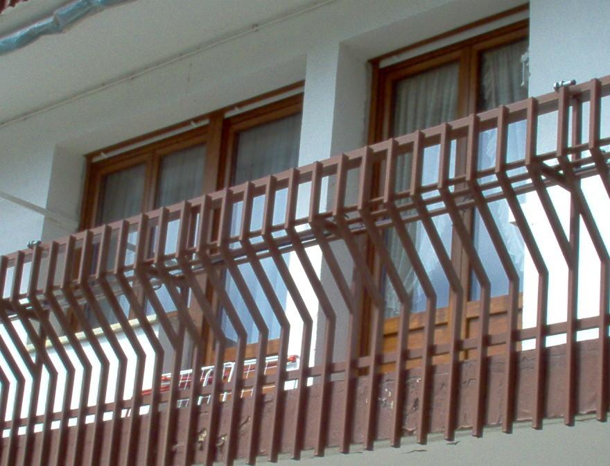 Puerta balconera en PVC de Kommerling en color embero 2