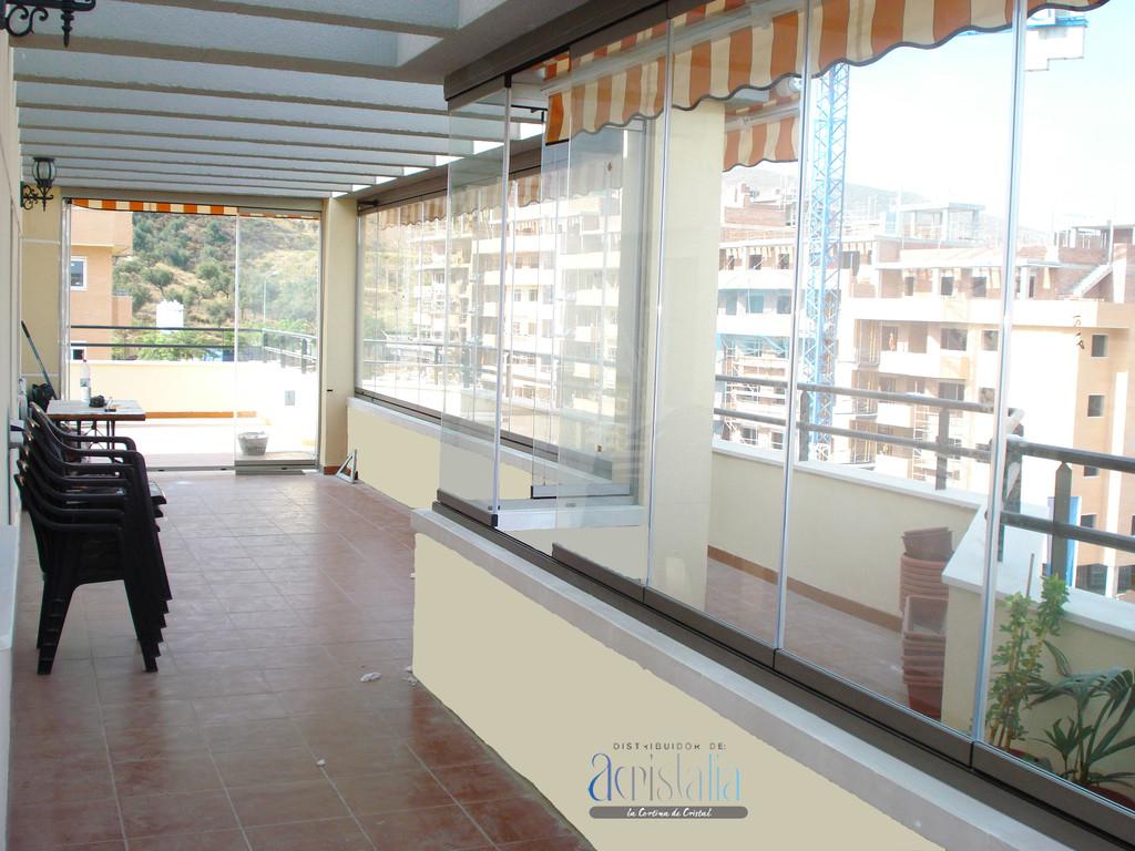 Cortina de vidrio en terraza