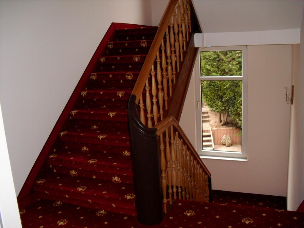 Treppenaufgang zu den Gästezimmern