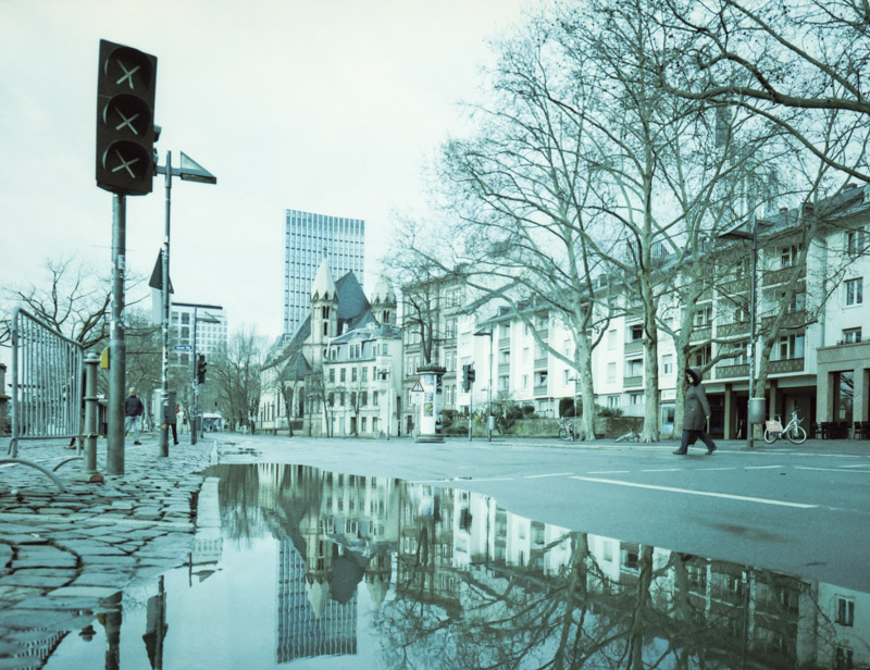 Reflection on the ground | LomoChrome Metropolis at 250 ISO with Fujifilm GA645Wi