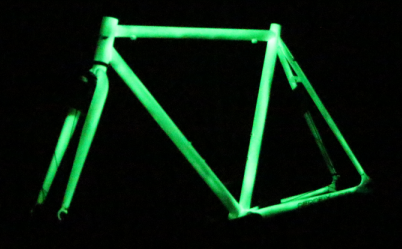 SWAN FLUO fixed bike: glow at night, white frame and fork.