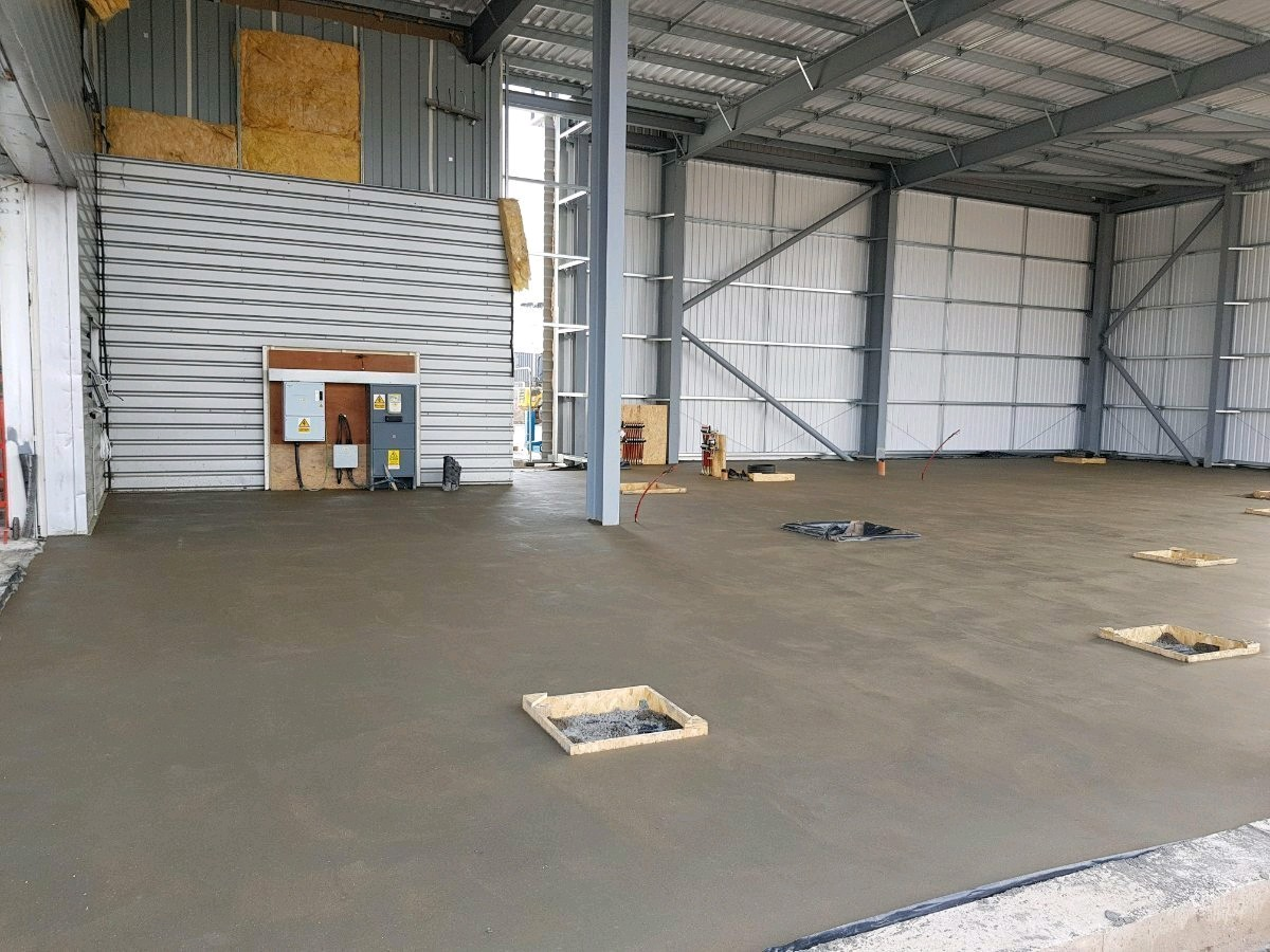 75mm ES Fibre Screed installed to 458m2 Ford Garage - Bristol