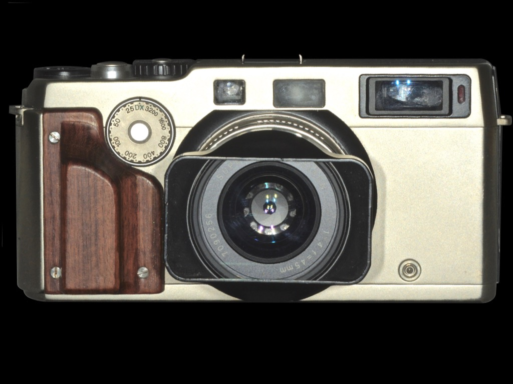 Fujifilm TX-1. Released: September 1998. Model: 35mm. Dual Format Rangefinder Camera. Screen size: 65 mm x 24 mm. Lens: Super EBC Fujinon TX45mm f4 *You can switch from dual format size to normal size by switching the lever on the back of the camera.