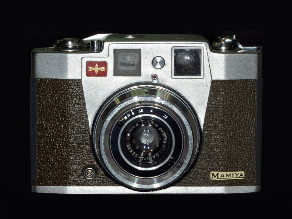 Mamiya Sketch.  Released: May 1959.  Model: 35mm . Square size Lens.  Shutter type camera. Screen size: 24 x 24 mm. Lens: Mamiya Secor 35mm F2.8. *A small camera that fits in the palm of your hand. You can shoot about 50 shots with 36-shot film