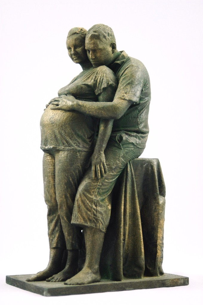 Pregnant couples in bronze