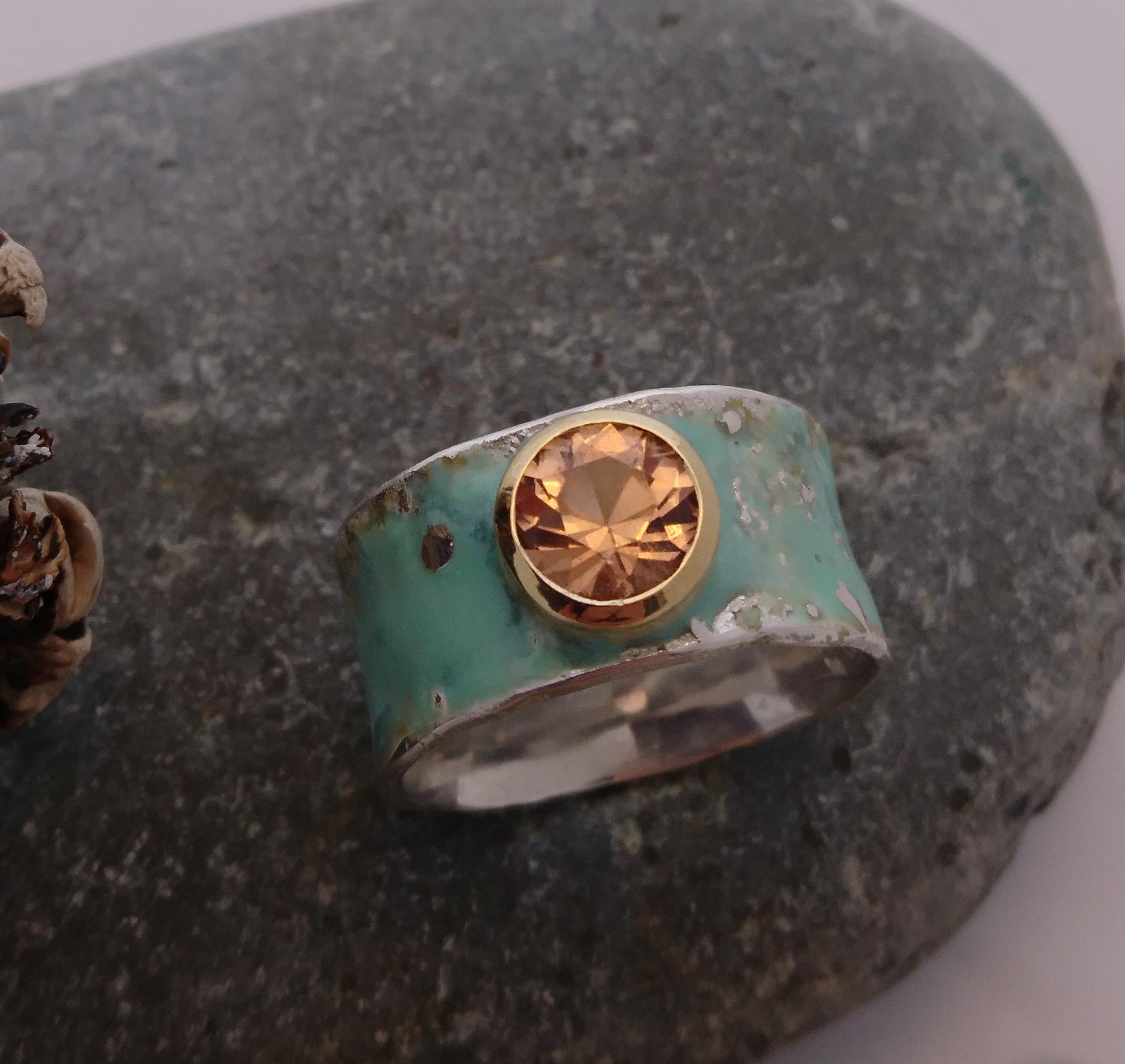 Ring, sterling silver, enamel, garnet (mined in Quebec, cut in Lunenburg) in 18k gold setting