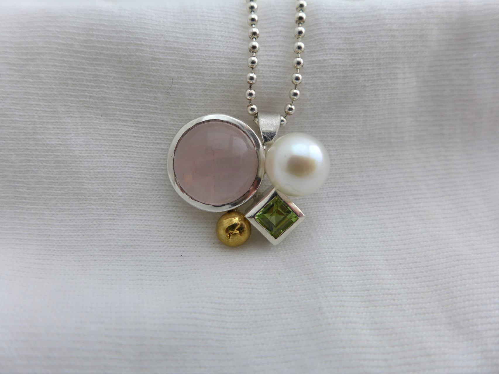 Pendant, sterling silver, fine silver, pink quartz, peridot, freshwater pearl and fine gold nugget