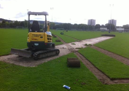 Removing the existing cricket pitch