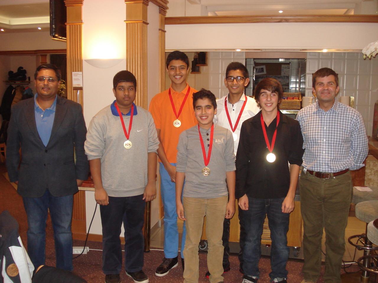 2013 Winners, l-r: Y.Sinh (Coach); Marishque Puvimamasinghe; Jai Sinh; Rohan Jain; Arjun Vinod; Aidan Andrews; J.Millar (Coach)