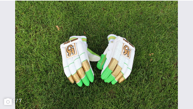 The batter's hands are protected with padded gloves. (Image: Tim Frei)