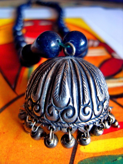 Gumbada necklace: close-up of carving on antique sterling-silver, jhumka-earring pendant