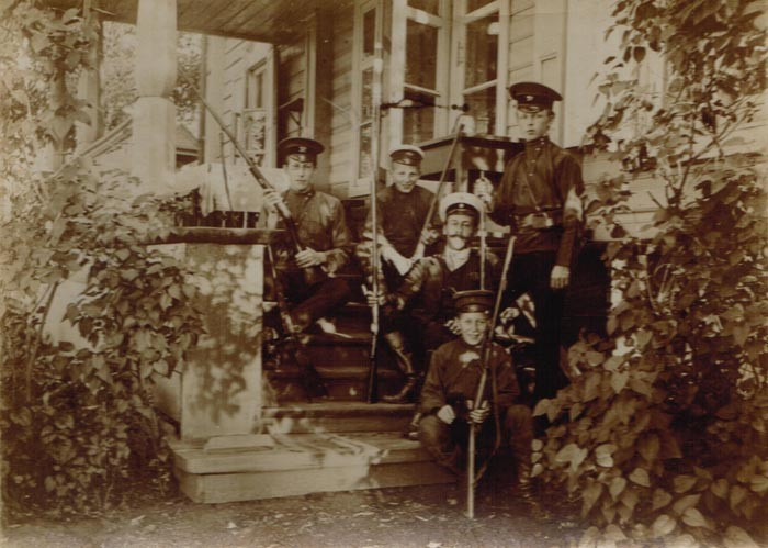 The Kogevin brothers with hunting rifles. Left to right: Constantin, Nikolai, chasseur, Eugene, Dmitry (the bottom row, sitting)