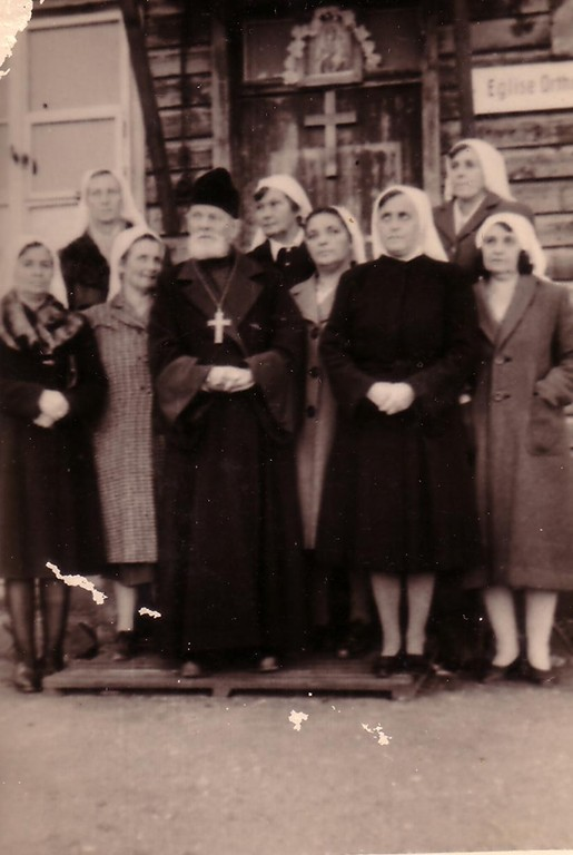 A Russian priest with his parishioners outside the Russian Orthodox Church in DP Camp in Kufstein, 1945-49.