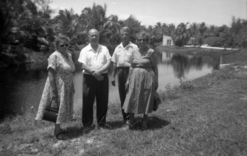 Left to right: Raissa and Eugene Kogevin with unknown people.