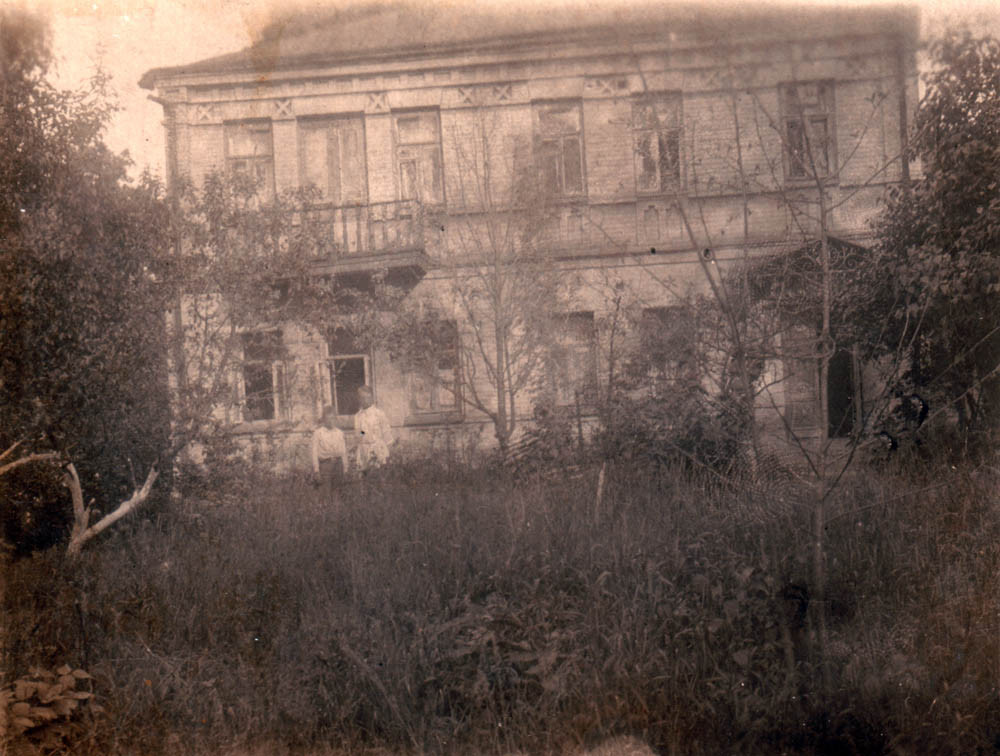 Mirik with his father outside his house. Kiev, Ovruchskaya St. 32. 1935.