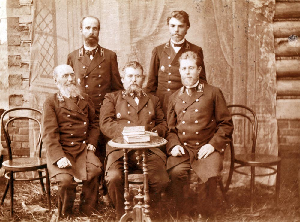 Vladimir F. Kogevin (left, sitting) with other officials