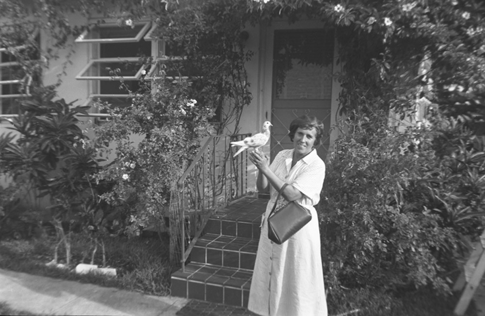 Raissa Kogevin with a pigeon near her house. 1953