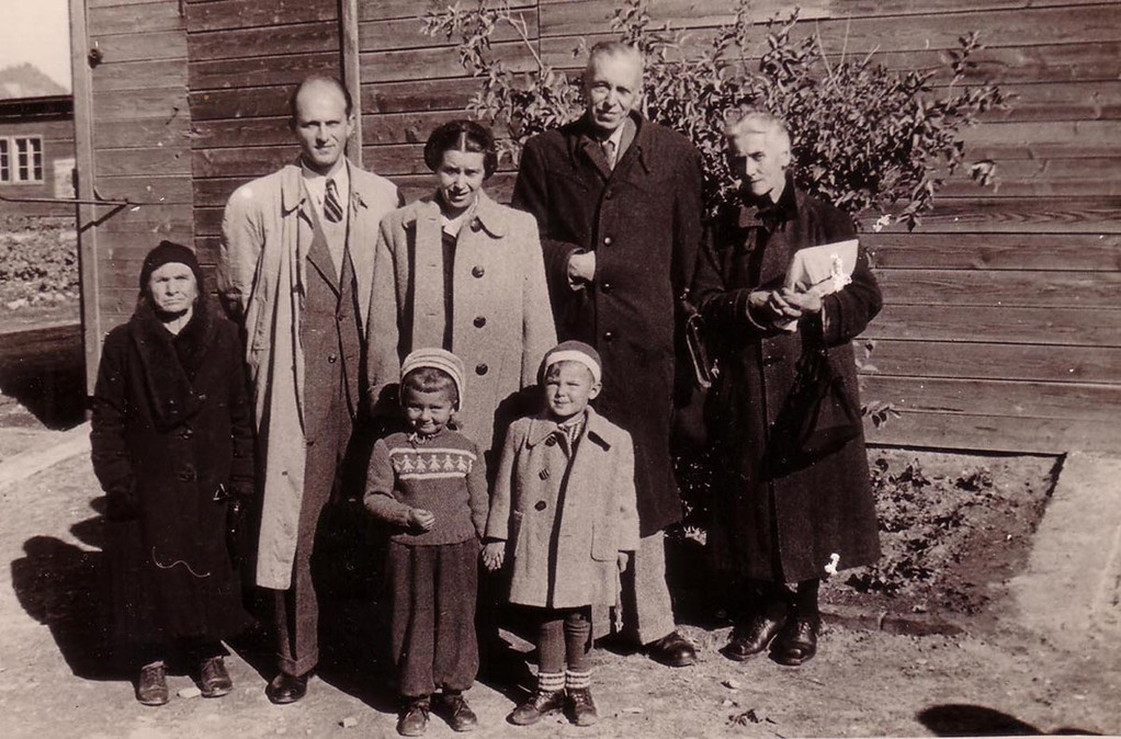A group of DPs in Kufstein. Left to right, second row (standing): an unknown person, Nicholas Hitrovo, Marina Sergeevna, Sergei, Glafira Ippolitivna Balitzky. In the first row are Hitrovo's children