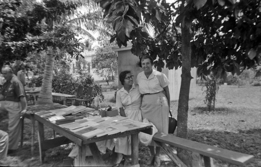 Raissa Kogevin talking to a book vendor near St. Vladimir Church, Miami, 1958.