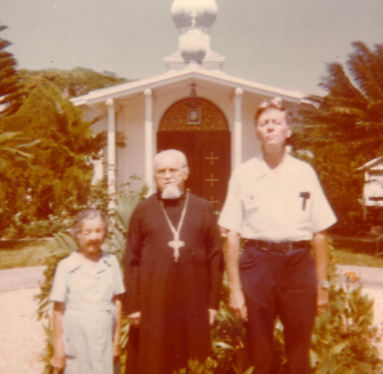 Maria Fillina with a priest and an unknown person near the St. Vladimir Church in Miami