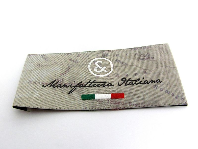 Extra high definition woven label with in-relief brocades and picture printed on the background