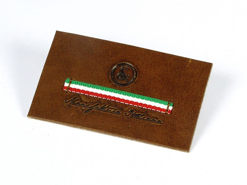 Real leather badge hot stamped with italian flag ribbon sewn