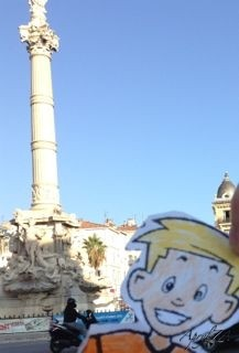 Flat Stanley poses at the Castellane monument in the 6ème quartier of Marseille