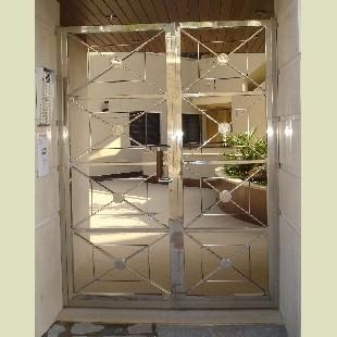 Puertas para casas en acero inoxidable en murcia for Puertas de acero inoxidable