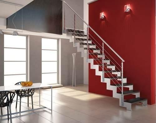 escalera de estructura perfilada en chapa de acero inoxidable barandilla en acero inoxidable y peldaos en madera