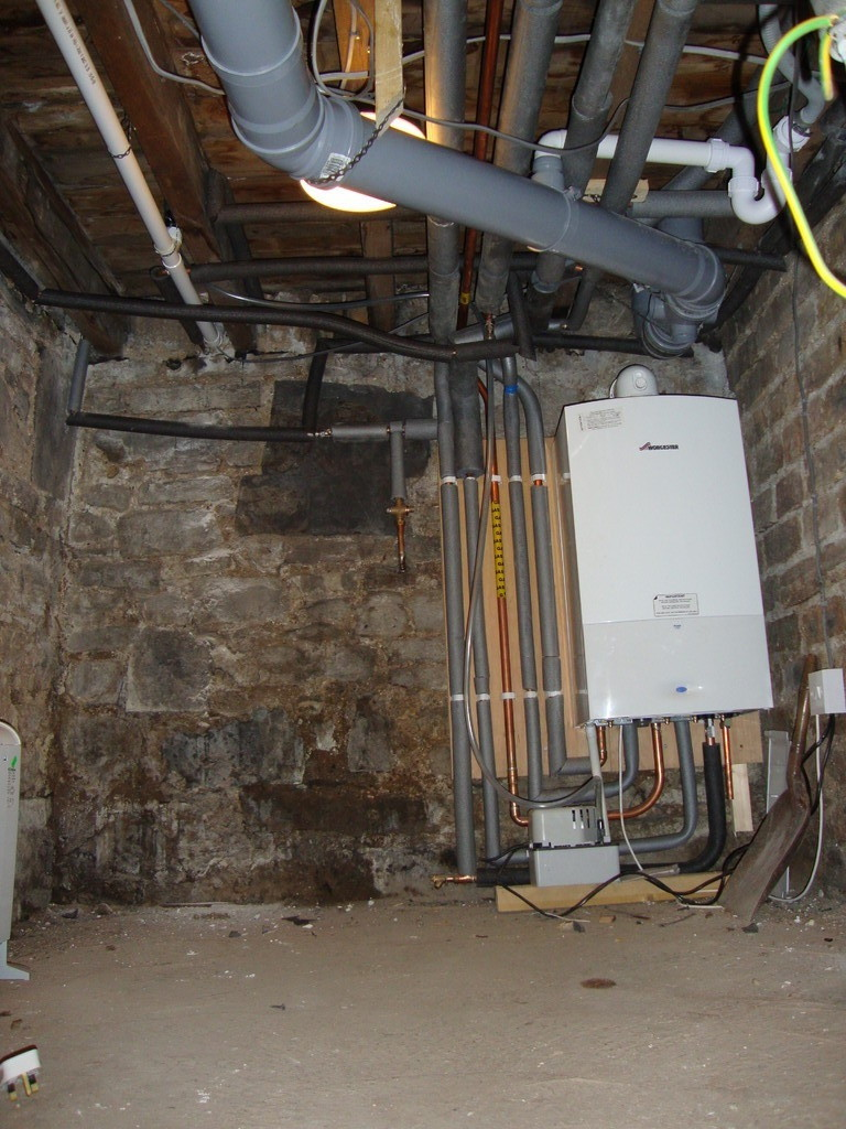 New boiler installed in basement area -freeing up room in utility