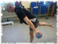 Personal Training Client performing a stork stance with shot balls
