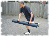 Client doing Ice-Skater exercise with a ViPR or rubber log
