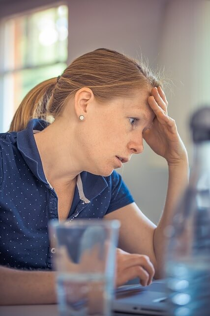Stressed woman at work.