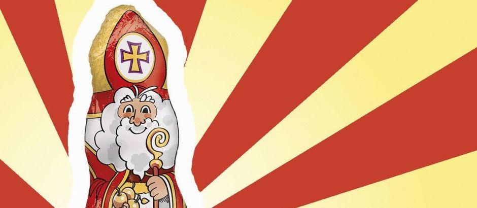 Ein Schokonikolaus mit Mitra ist zu sehen. Im Hintergrund sind rote und gelbe Streifen.