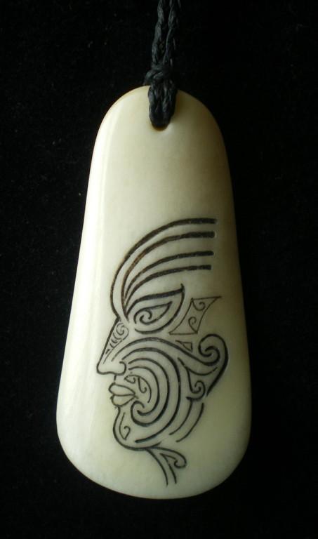 #43 Moko man shoe horn/sold