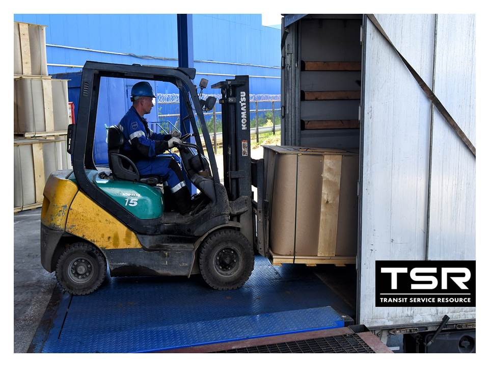 Forklift  loading the IBC in to the  truck