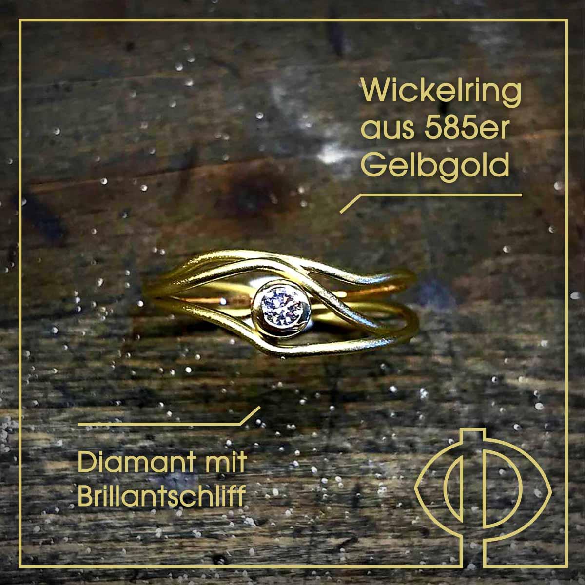 Wickelring aus 585er Gelbgold mit Diamant in Brillantschliff