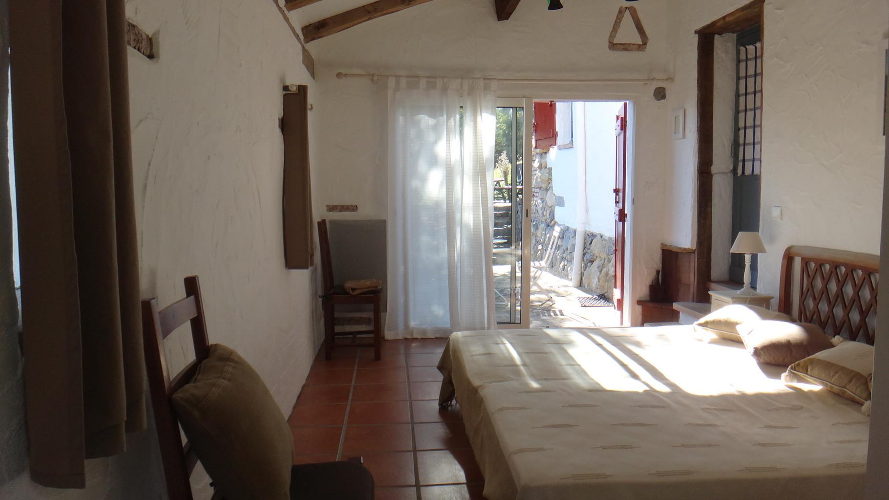 Vue de la chambre sur la deuxième terrasse