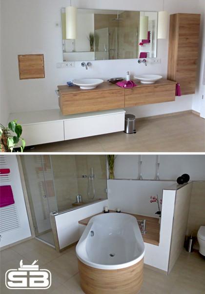 Waschtischunterschrank mit Aufsatzwaschbecken und passender Badewannenumrandung